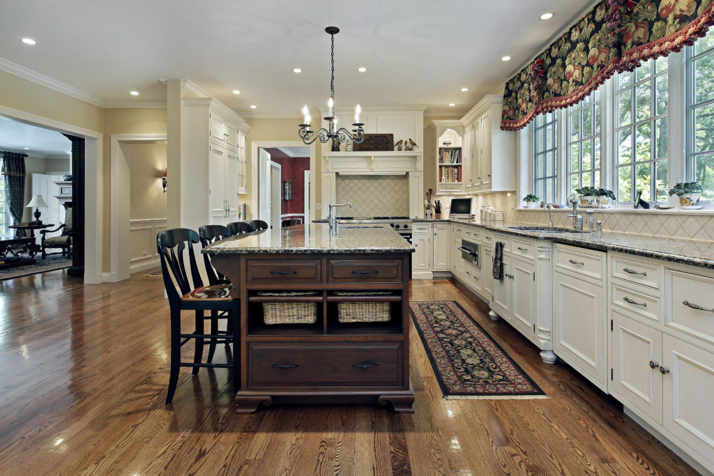 DDBuild-A new custom Chef's style kitchen with white cabinets, chestnut color kitchen Island and oak floors