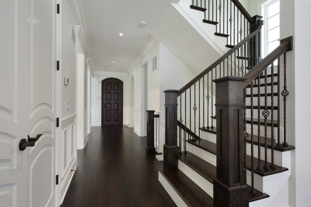 DDBuild-A new custom home white hallway and new wood staircase