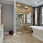 DDBuild-A soft gray and french style soft butter cabinets for a custom master bath addition